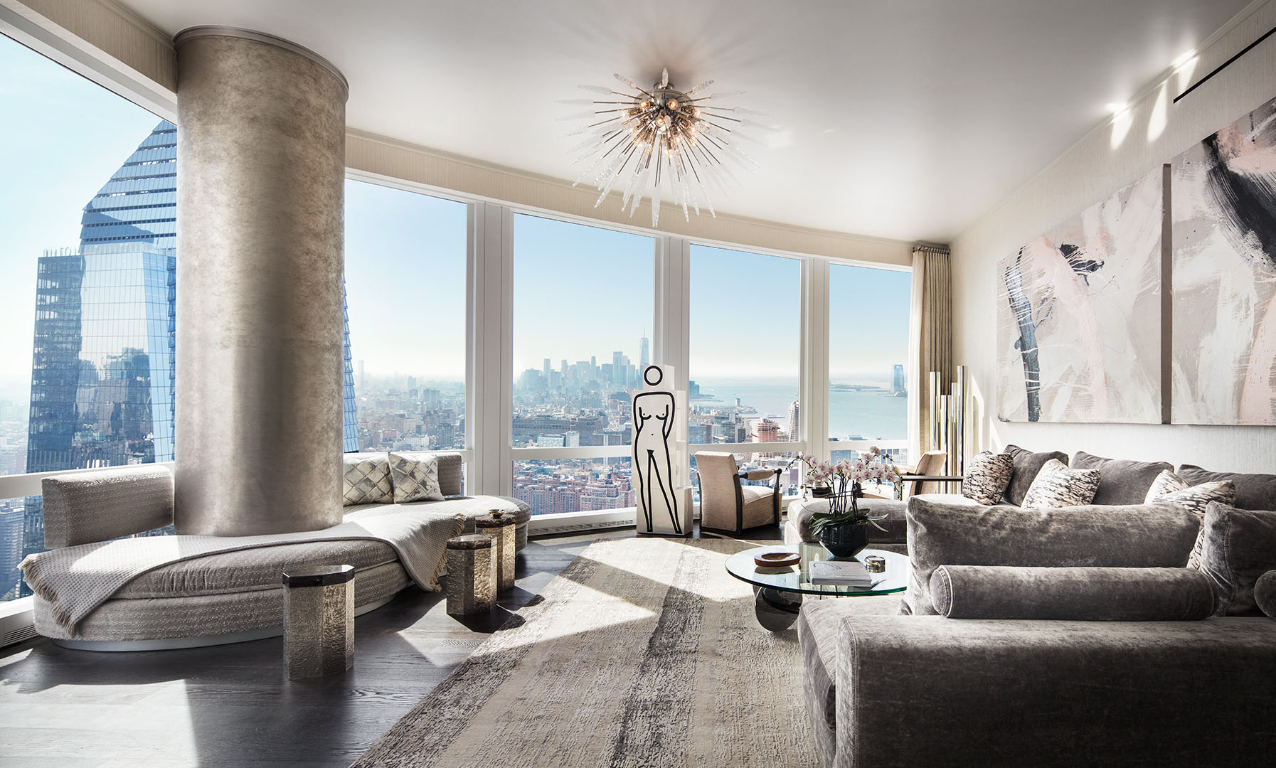 Living room with expansive Hudson River and city views